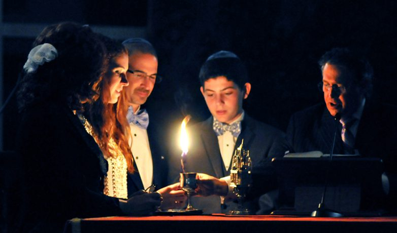 WJC Mitzvahs people lighting candle